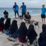 CD Trainer, Pau, teaches local children about coral reef restoration