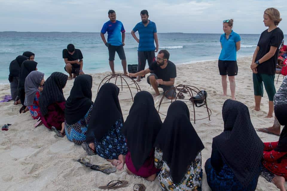 CD Trainer, Pau, teaches local children about coral reef restoration